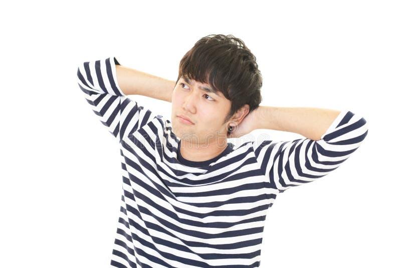 Homem asiático forçado foto de stock royalty free