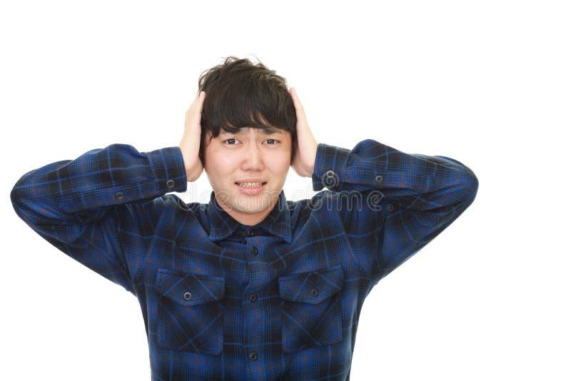 Homem asiático frustrante fotografia de stock