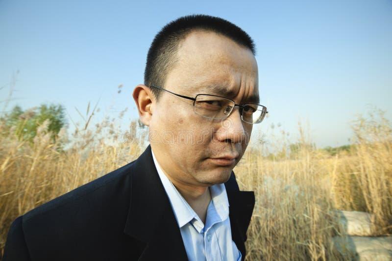 Homem asiático irritado imagens de stock royalty free