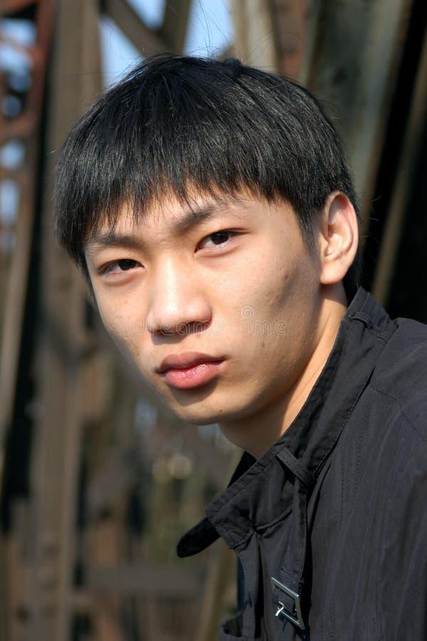 Homem asiático novo foto de stock