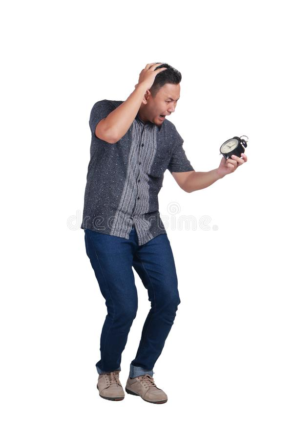 Homem asiático novo assustado do tempo atrasa foto de stock
