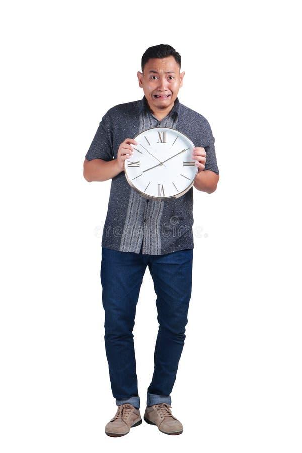 Homem asiático novo assustado do tempo atrasa imagens de stock