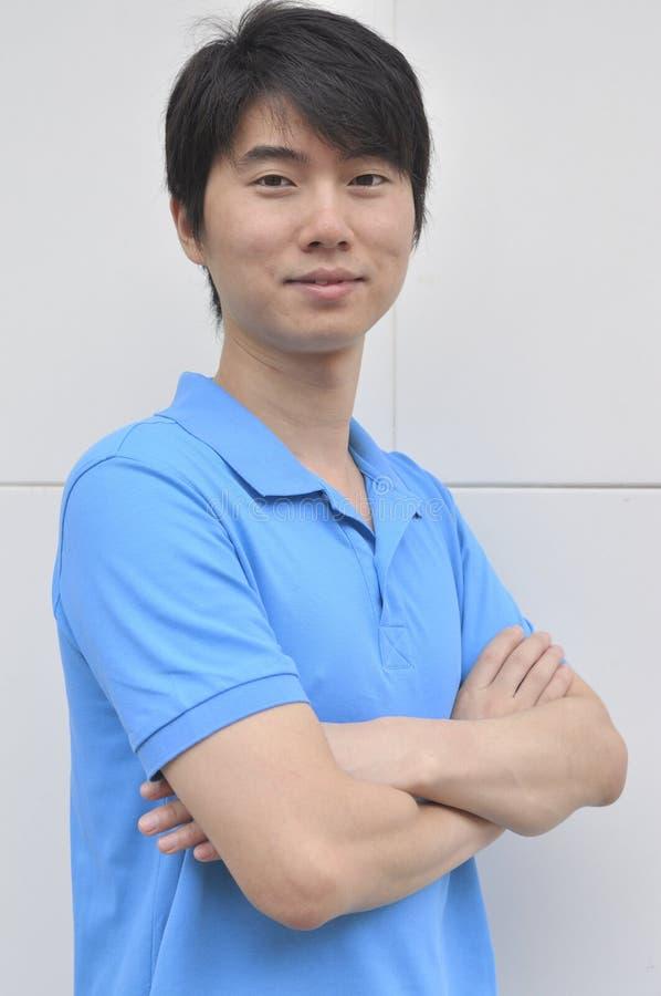 Homem asiático novo confiável foto de stock