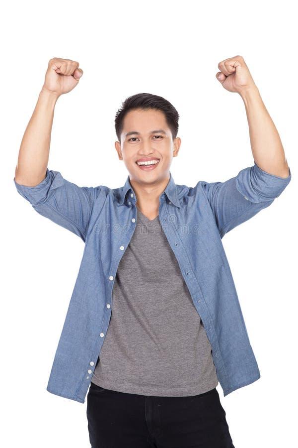 Homem asiático novo entusiasmado feliz imagem de stock royalty free