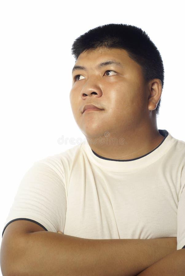 Homem asiático que olha ao lado foto de stock