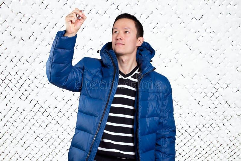Homem asiático triste no azul foto de stock royalty free