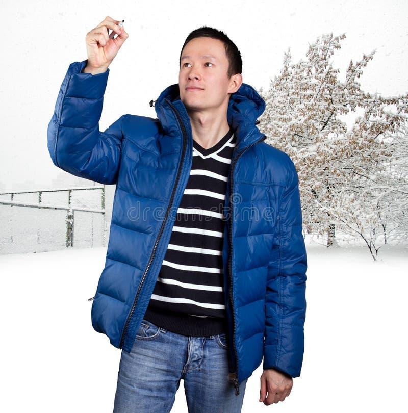 Homem asiático triste no azul fotos de stock