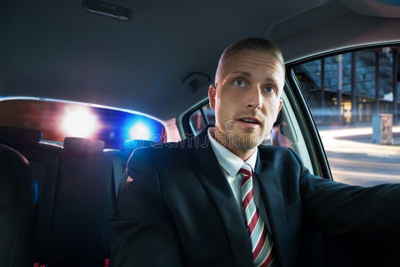 Homem assustado puxado sobre pela polícia fotografia de stock royalty free