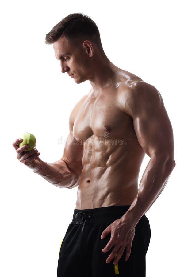 Homem atlético com maçã fotografia de stock royalty free