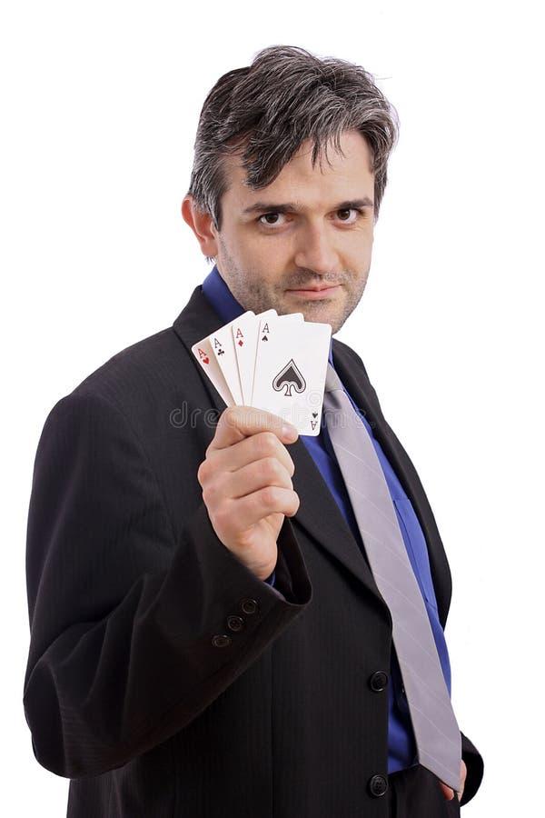 Homem atrativo com cartões de jogo foto de stock