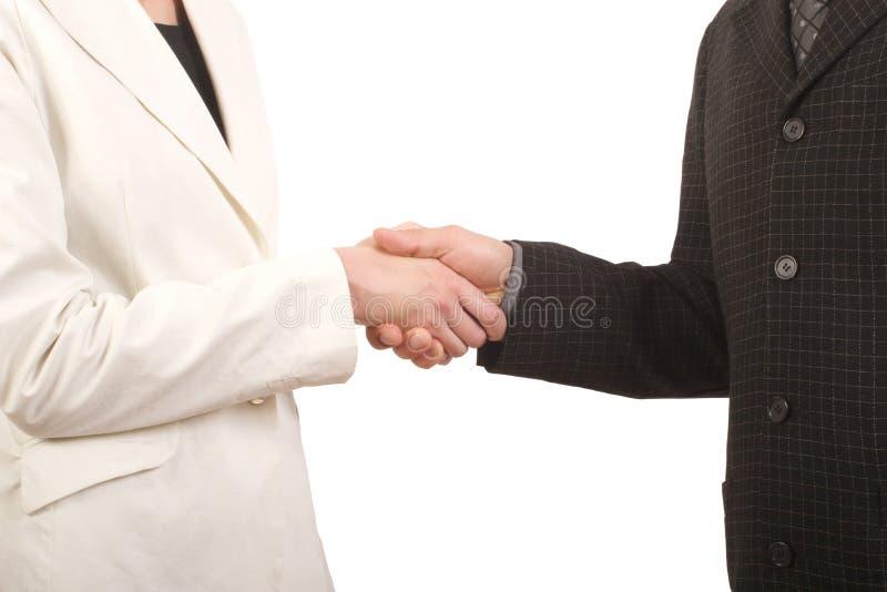 Homem branco e mulher - aperto de mão do negócio fotos de stock royalty free