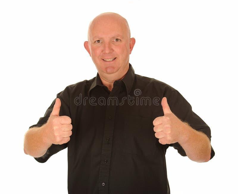 Homem calvo com polegares acima fotos de stock royalty free