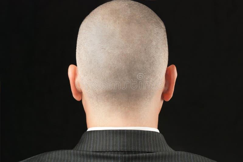 Homem calvo no terno de atrás imagem de stock