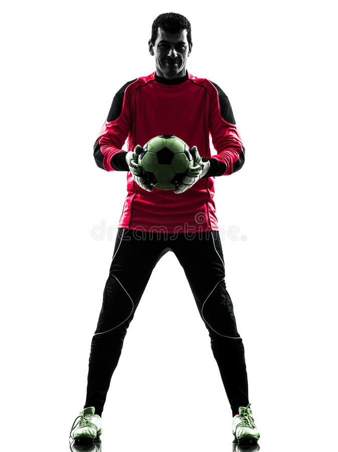 Homem caucasiano do goleiros do jogador de futebol que guarda a silhueta da bola fotos de stock royalty free