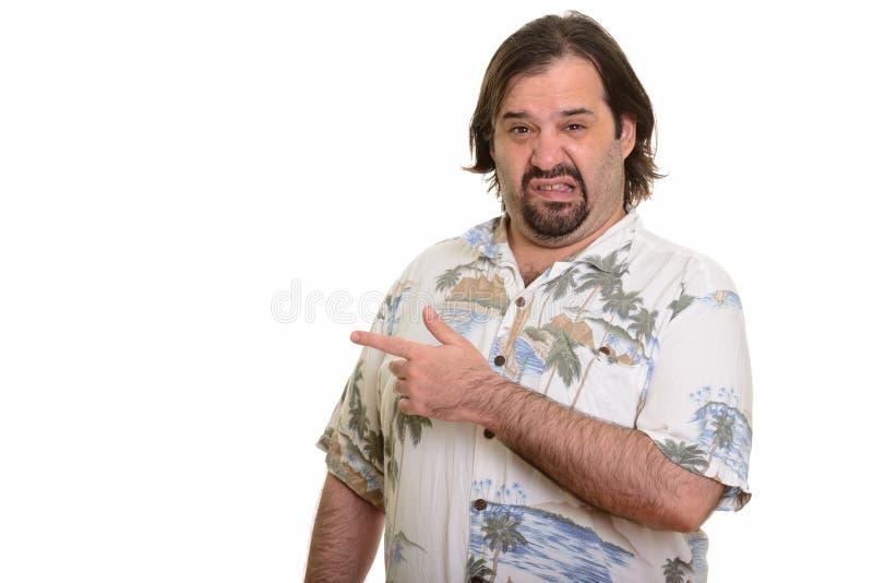 Homem caucasiano gordo que aponta o dedo que olha pronto enojado para o va fotografia de stock