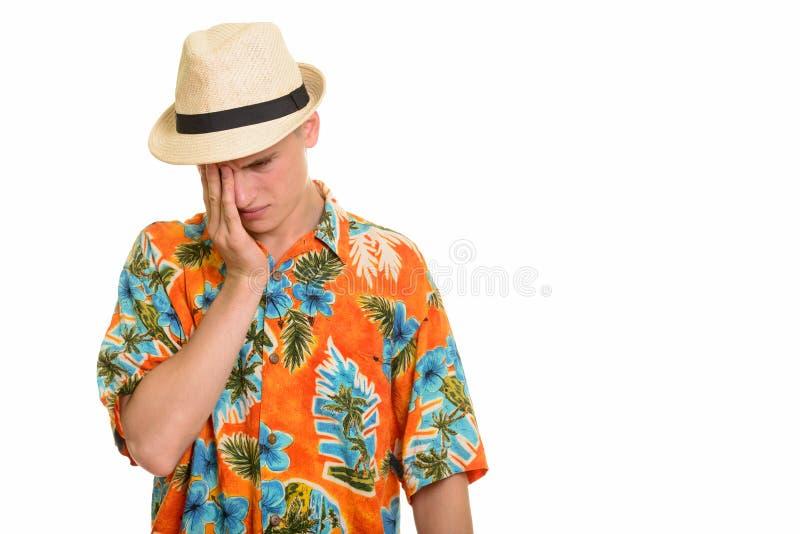 Homem caucasiano novo do turista que olha forçado e esgotado fotos de stock royalty free