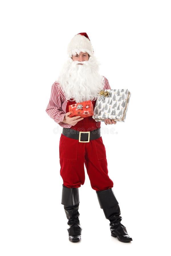 Homem caucasiano novo Papai Noel, presentes imagens de stock