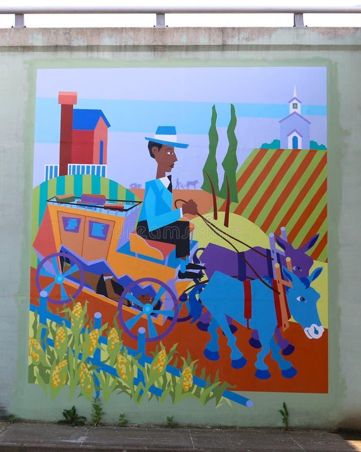 Homem colorido em uma pintura mural puxado a cavalo do transporte em James Road em Memphis, Tennessee fotografia de stock royalty free