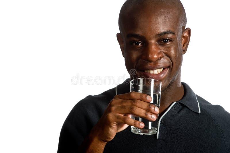 Homem com água fotos de stock royalty free