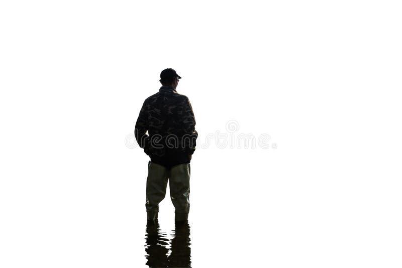 Homem com as botas isoladas no fundo branco, de atrás imagem de stock royalty free