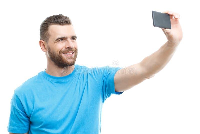 Homem com a barba que faz o selfie fotos de stock royalty free