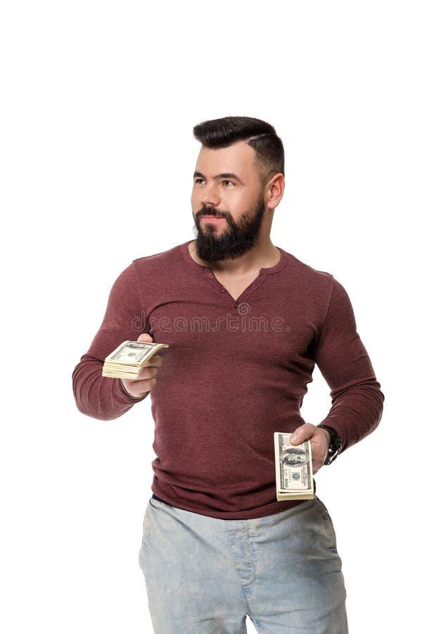 Homem com a barba que guarda o dinheiro imagem de stock