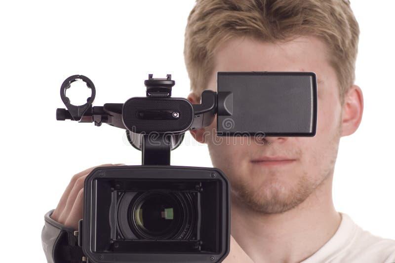 Homem com câmara de vídeo video foto de stock