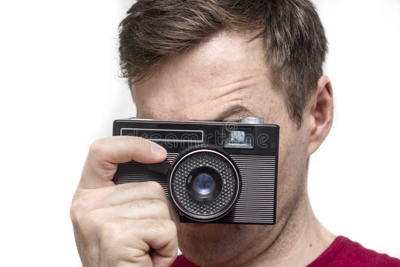 Homem com câmera velha fotos de stock