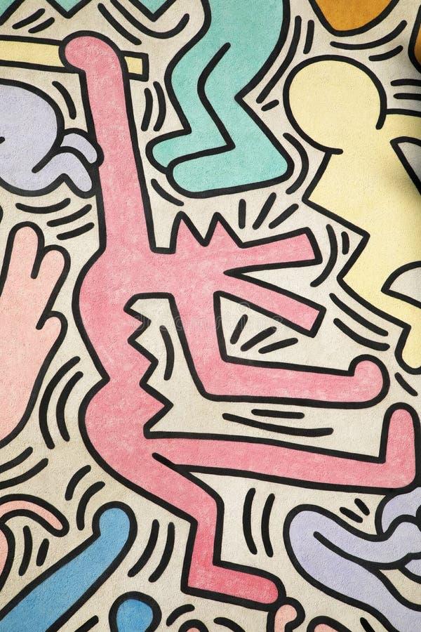 Homem com a cabeça de um lobo pintada por Keith Haring imagens de stock royalty free