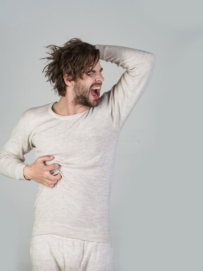 Homem com cabelo bagun?ado no roupa interior fotos de stock royalty free