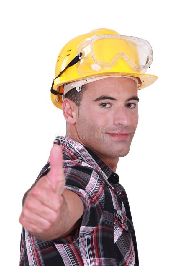 Homem com capacete de segurança e óculos de proteção fotografia de stock royalty free