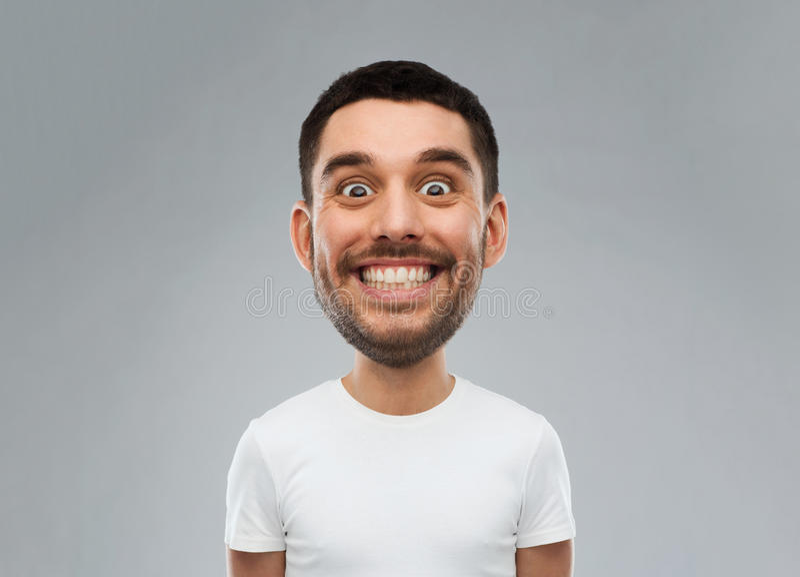 Homem com a cara engraçada sobre o fundo cinzento foto de stock royalty free