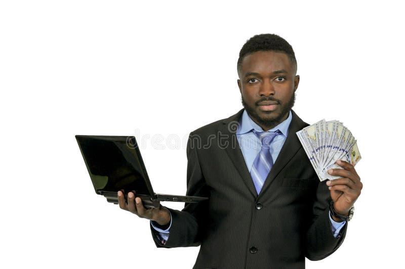 Homem com computador e dinheiro fotos de stock