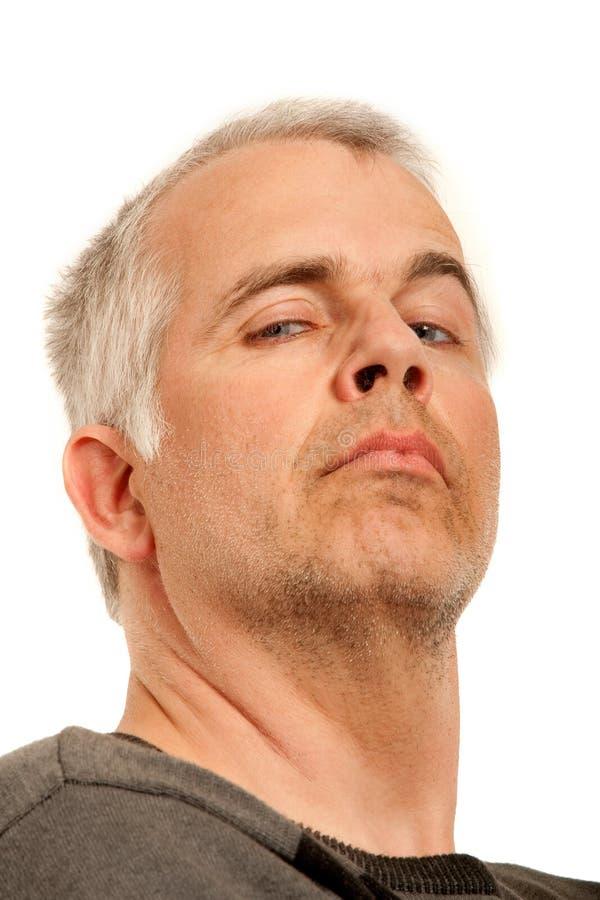Homem com expressão arrogante fotografia de stock royalty free