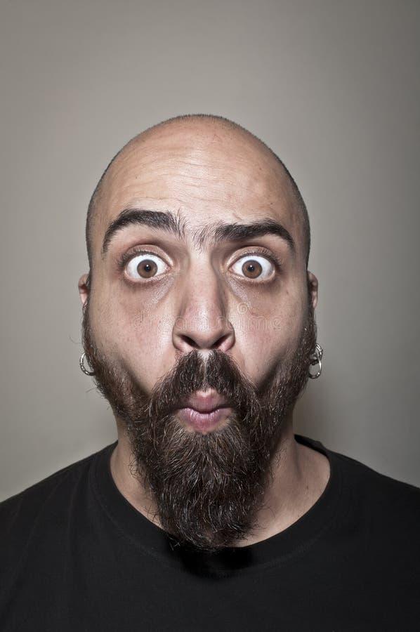 Homem com face estúpida fotografia de stock royalty free