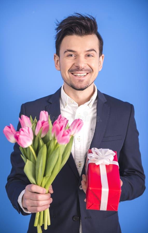Homem com flores fotos de stock royalty free