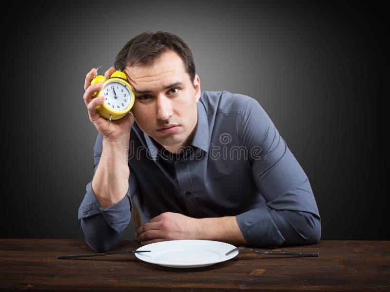 Homem com fome foto de stock