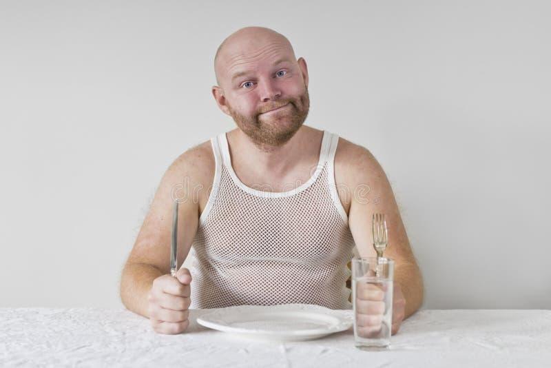 Homem com fome e feliz imagens de stock royalty free
