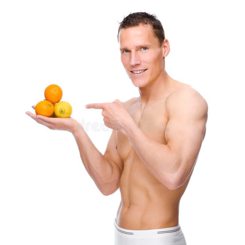 Download Homem com frutas imagem de stock. Imagem de saudável - 16866685