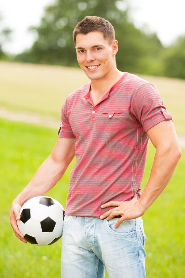 Homem com futebol foto de stock royalty free