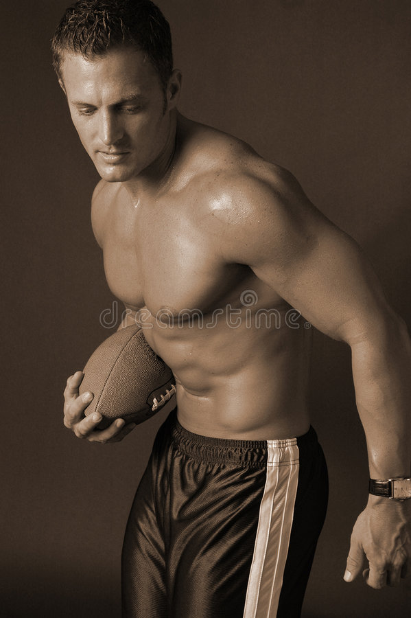 Homem com futebol foto de stock