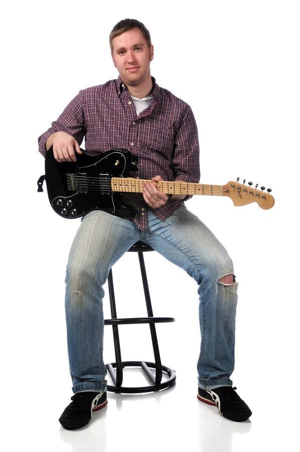 Homem com guitarra elétrica foto de stock