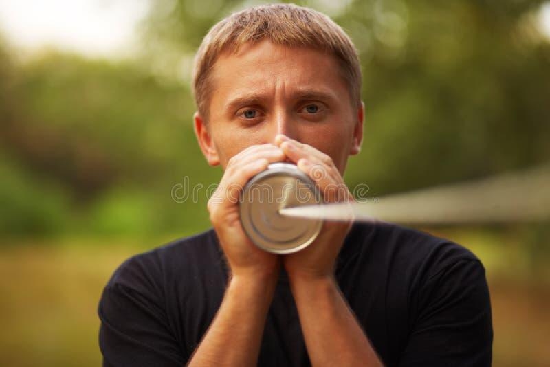 Homem com lata fotos de stock royalty free