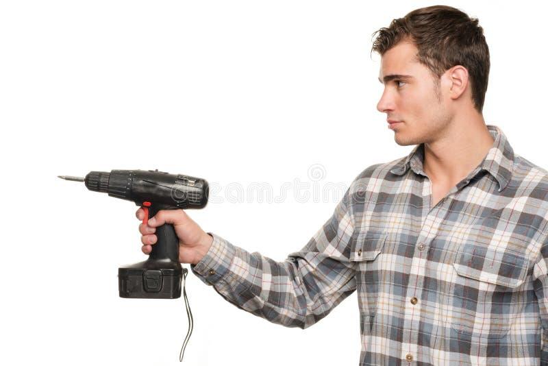 Homem com máquina da broca imagens de stock royalty free