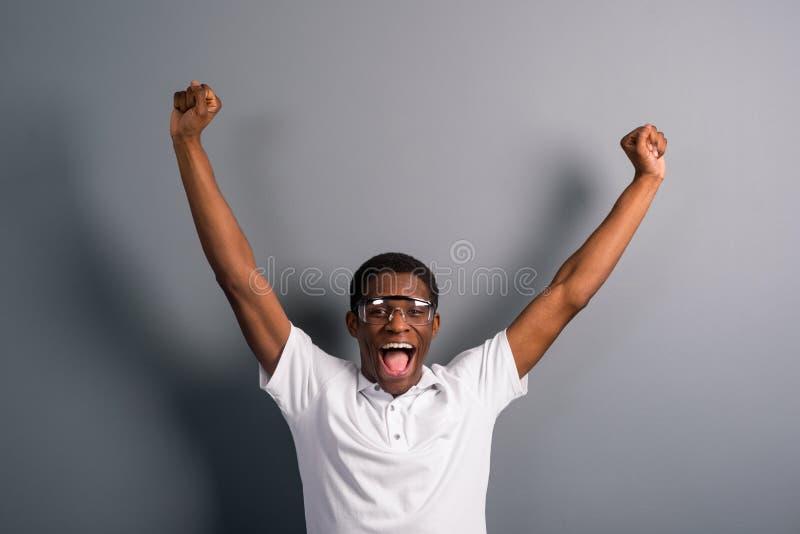 Homem com mãos acima imagens de stock royalty free