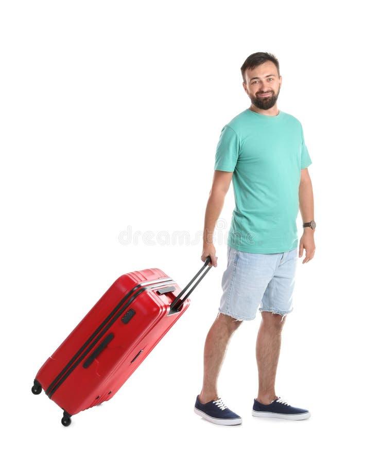 Homem com a mala de viagem no fundo branco fotos de stock royalty free