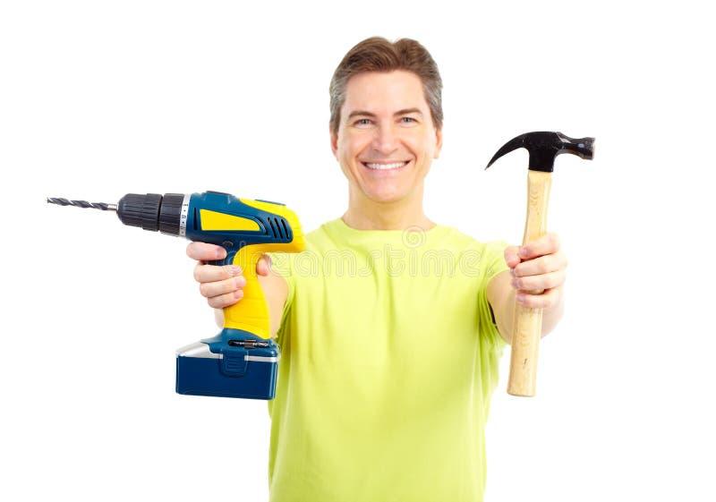 Download Homem com martelo e broca foto de stock. Imagem de trabalhador - 12805418