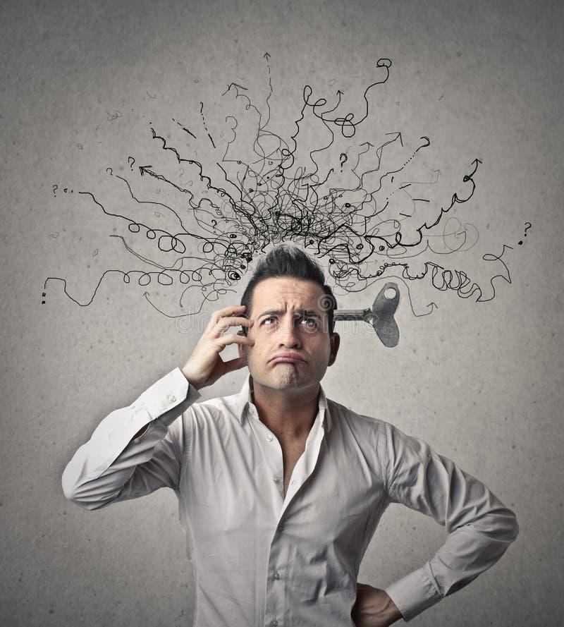 Homem com mola em seu cérebro fotos de stock royalty free