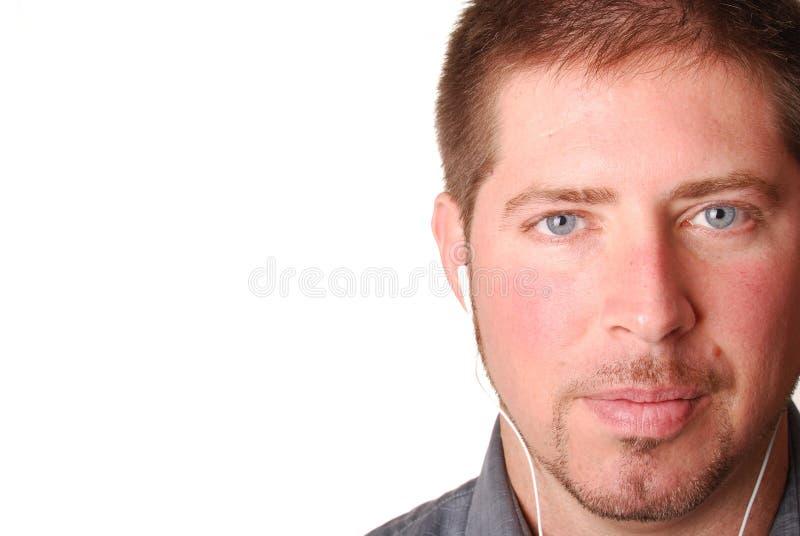 Homem com o jogador mp3 imagens de stock royalty free