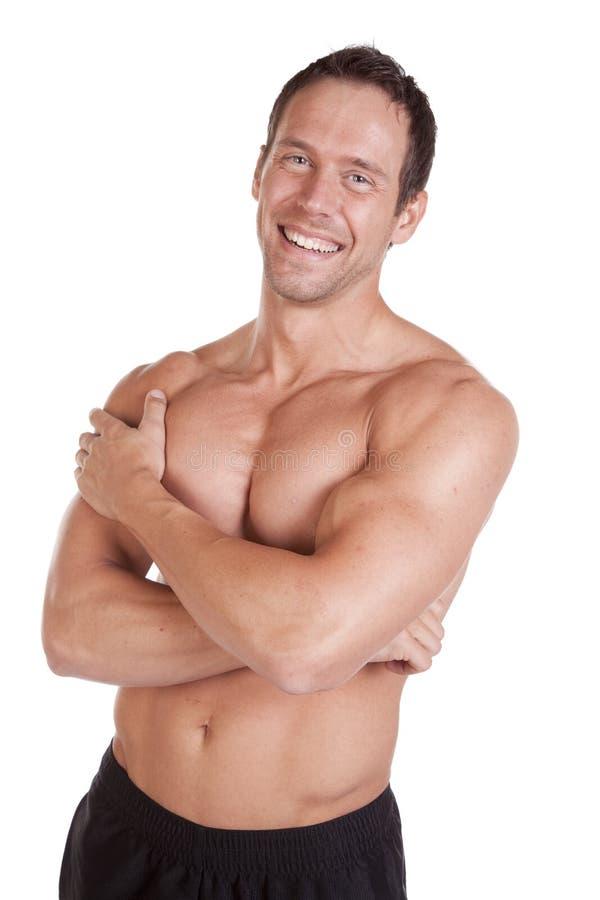 Homem com os braços dos músculos cruzados foto de stock royalty free
